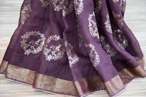 Buy purple linen saree online in USA with zari border and bird nest motifs. Make your ethnic style even more stylish with an exclusive range on Indian handloom sarees from Pure Elegance Indian fashion store in USA. -pleats