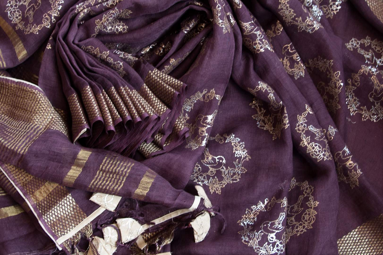 Buy purple linen saree online in USA with zari border and bird nest motifs. Make your ethnic style even more stylish with an exclusive range on Indian handloom sarees from Pure Elegance Indian fashion store in USA. -details