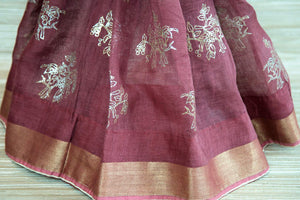 Buy rosewood pink linen sari online in USA with zari border and bird nest motifs. Make your ethnic style even more stylish with an exclusive range on Indian handloom sarees from Pure Elegance Indian fashion store in USA. -pleats