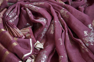 Buy rosewood pink linen sari online in USA with zari border and bird nest motifs. Make your ethnic style even more stylish with an exclusive range on Indian handloom sarees from Pure Elegance Indian fashion store in USA. -details