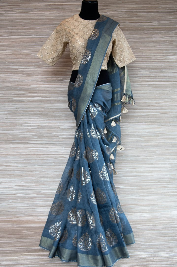 Buy blue linen sari online in USA with zari border and plant motifs. Make your ethnic style even more stylish with an exclusive range on Indian handloom sarees from Pure Elegance Indian fashion store in USA. -full view