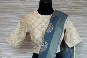 Buy blue linen sari online in USA with zari border and plant motifs. Make your ethnic style even more stylish with an exclusive range on Indian handloom sarees from Pure Elegance Indian fashion store in USA. -blouse pallu