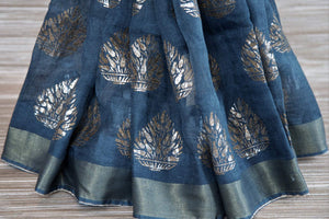 Buy blue linen sari online in USA with zari border and plant motifs. Make your ethnic style even more stylish with an exclusive range on Indian handloom sarees from Pure Elegance Indian fashion store in USA. -pleats