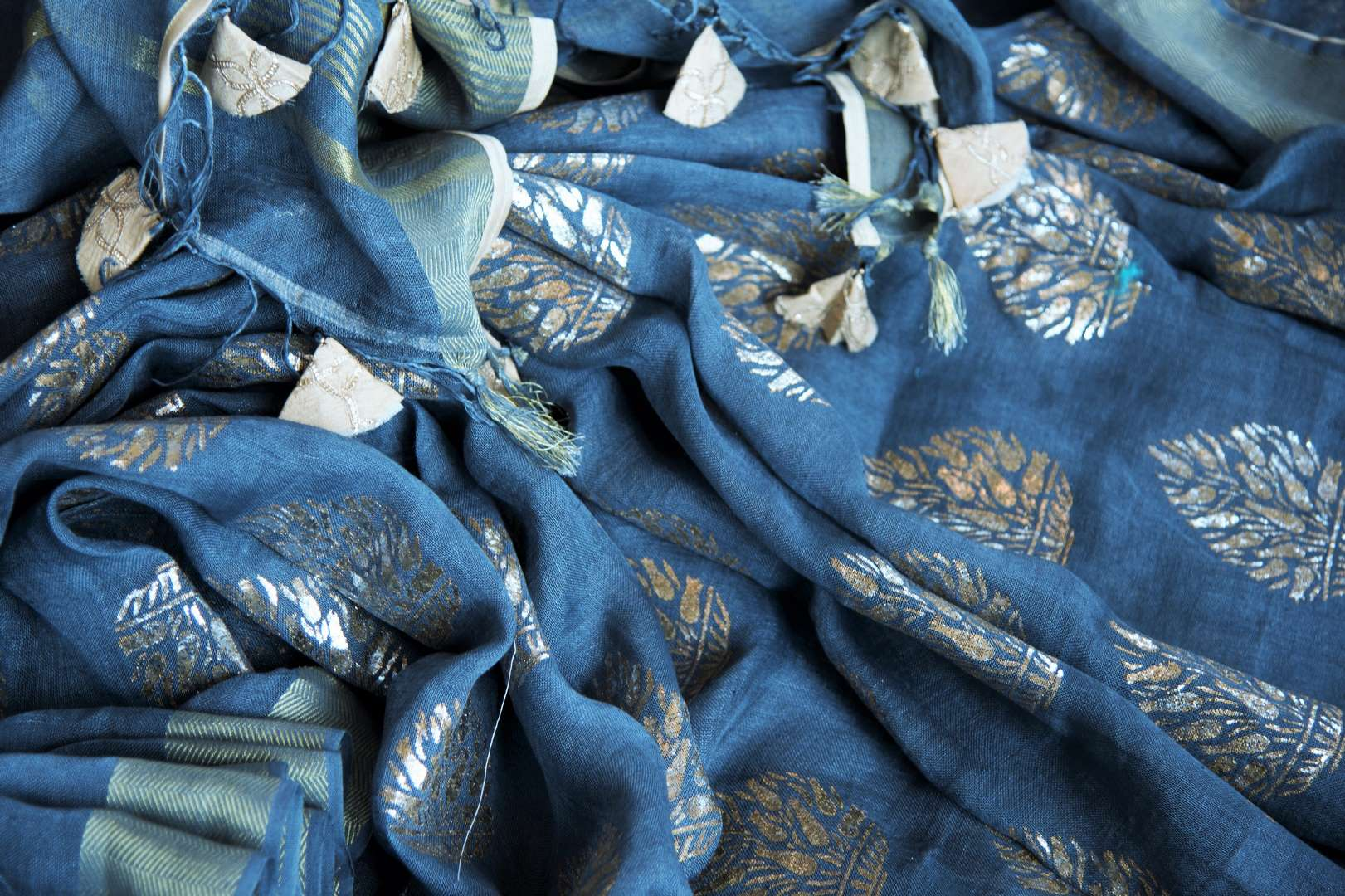 Buy blue linen sari online in USA with zari border and plant motifs. Make your ethnic style even more stylish with an exclusive range on Indian handloom sarees from Pure Elegance Indian fashion store in USA. -details