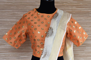 Buy cream linen sari online in USA with floral print and orange sari blouse. Select your favorite Indian sarees, pure silk sarees, wedding sarees from Pure Elegance Indian fashion store in USA for weddings and special occasions.-blouse pallu