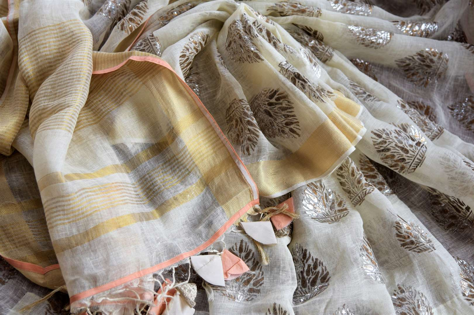 Buy cream linen sari online in USA with floral print and orange sari blouse. Select your favorite Indian sarees, pure silk sarees, wedding sarees from Pure Elegance Indian fashion store in USA for weddings and special occasions.-details