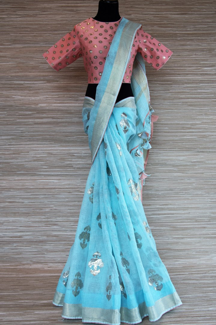 Buy sky blue linen saree online in USA with zari border and pink saree blouse. Make your ethnic style even more stylish with an exclusive range on Indian handloom sarees from Pure Elegance Indian fashion store in USA. -full view