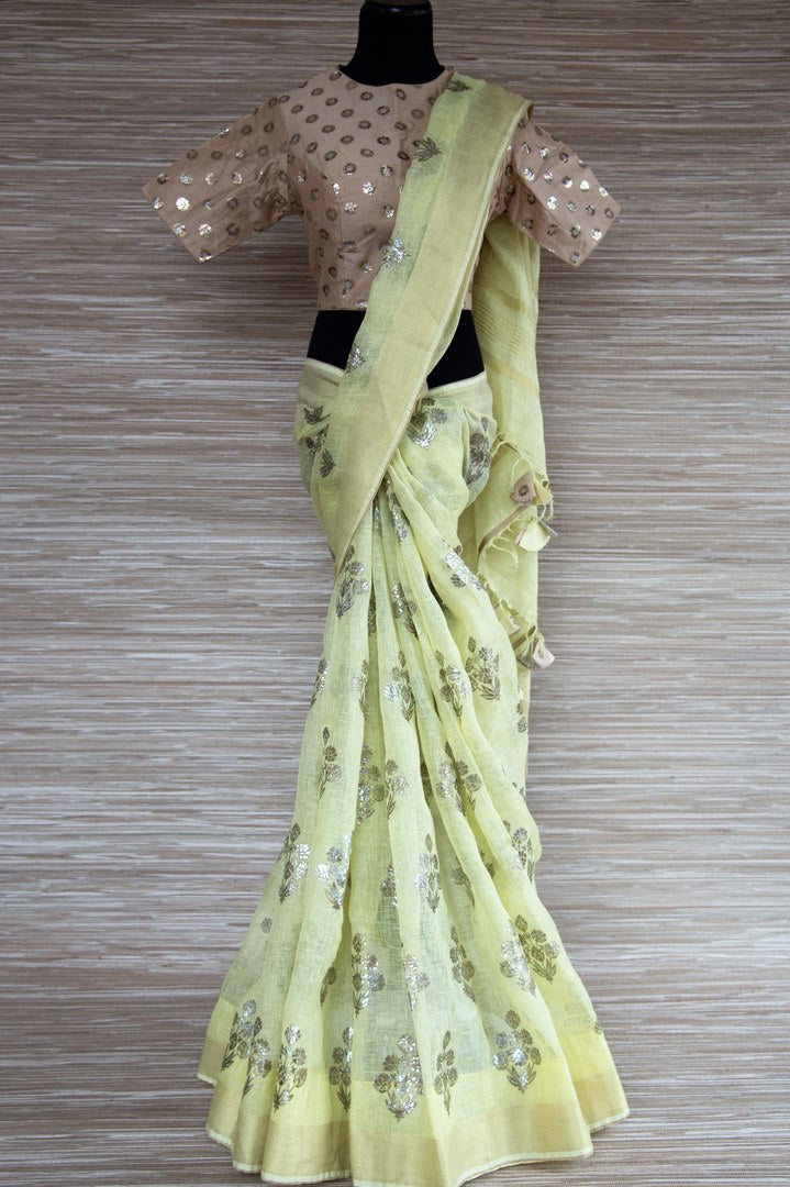 Buy yellow linen saree online in USA with zari border and beige saree blouse. Make your ethnic style even more stylish with an exclusive range on Indian handloom sarees from Pure Elegance Indian fashion store in USA. -full view