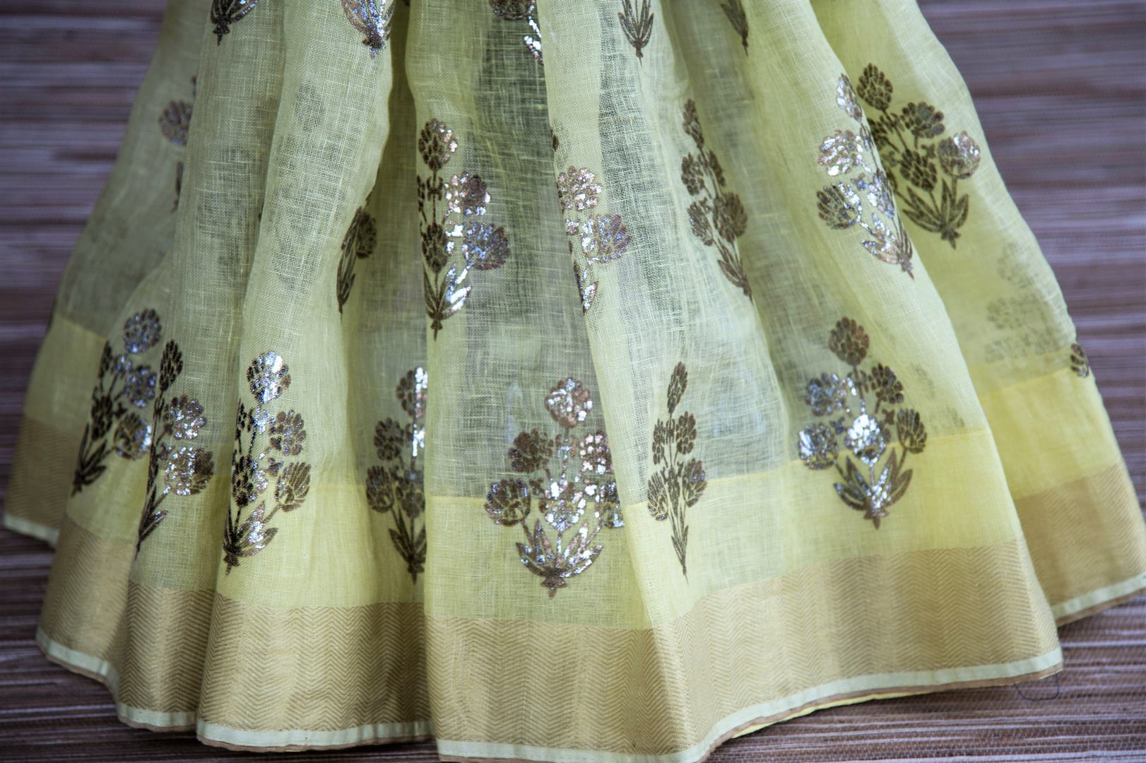 Buy yellow linen saree online in USA with zari border and beige saree blouse. Make your ethnic style even more stylish with an exclusive range on Indian handloom sarees from Pure Elegance Indian fashion store in USA. -pleats