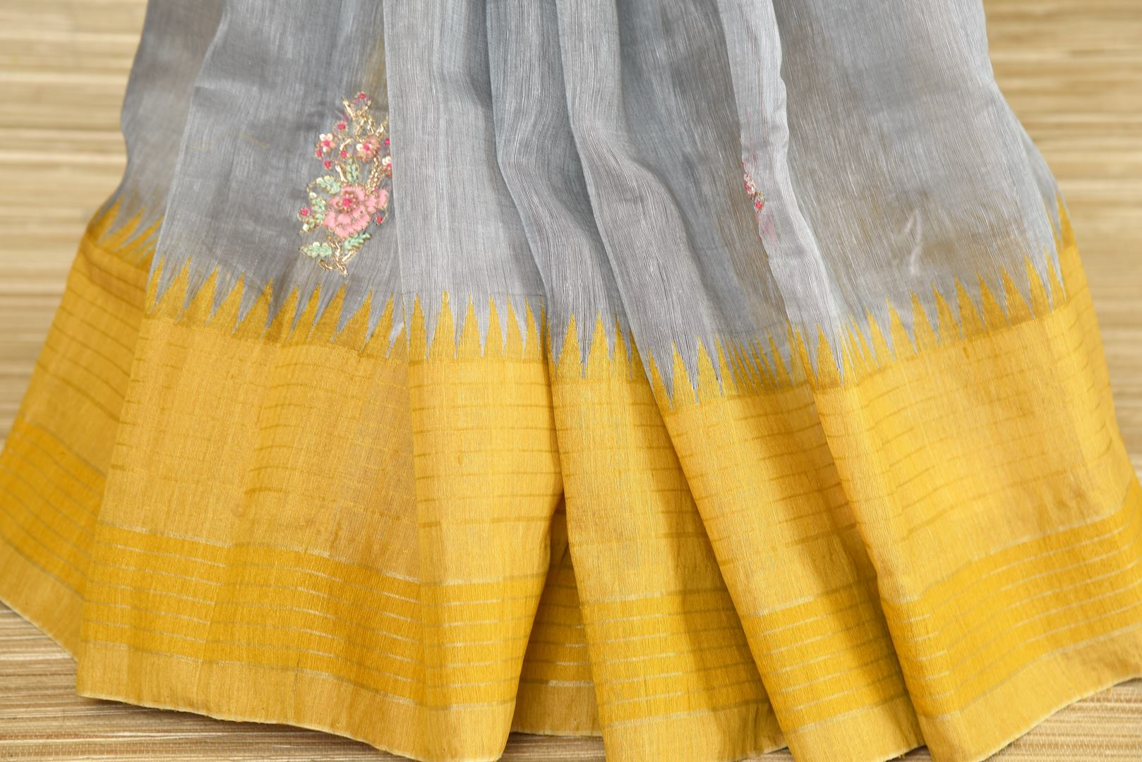 Buy grey embroidered linen saree online in USA with yellow border. Elevate your ethnic style with a tasteful collection of Indian handwoven sarees from Pure Elegance Indian clothing store in USA.-pleats