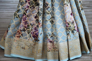 Shop powder blue floral print georgette Benarasi saree online in USA with zari jaal. Shop such finely handcrafted Indian saris from Pure Elegance Indian fashion store in USA for weddings and special occasions.-pleats