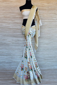 Buy powder blue floral georgette Benarasi saree online in USA with zari buta and zari border. Select your favorite Indian sarees, pure silk sarees, wedding sarees from Pure Elegance Indian fashion store in USA for weddings and special occasions.-full view