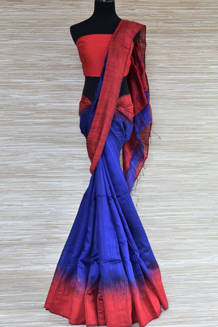 Buy indigo blue matka silk saree online in USA with red border. Select your favorite Indian handloom sarees, pure silk sarees, wedding sarees from Pure Elegance Indian fashion store in USA for weddings and special occasions.-full view