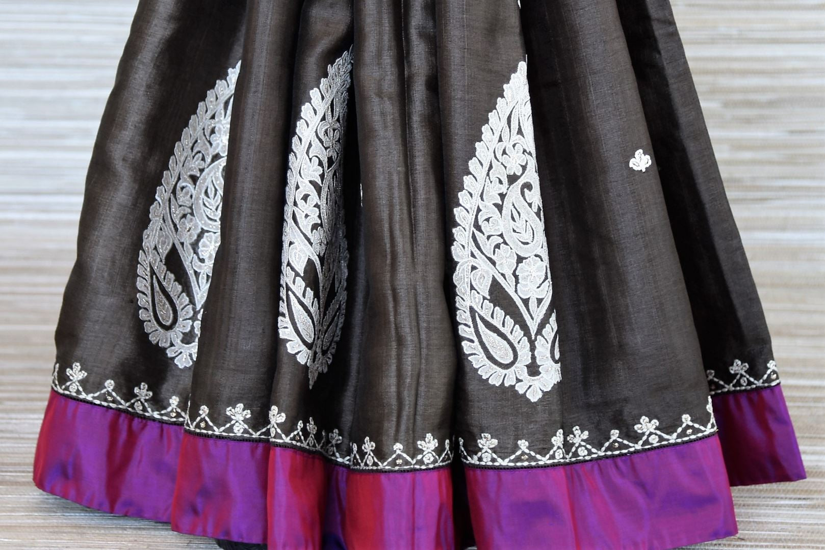 Buy dark grey applique work tussar saree online in USA with purple border. Be the talk of every occasions with your elegant saree look in designer sarees, embroidered sarees, handwoven silk sarees from Pure Elegance Indian fashion store in USA.-pleats