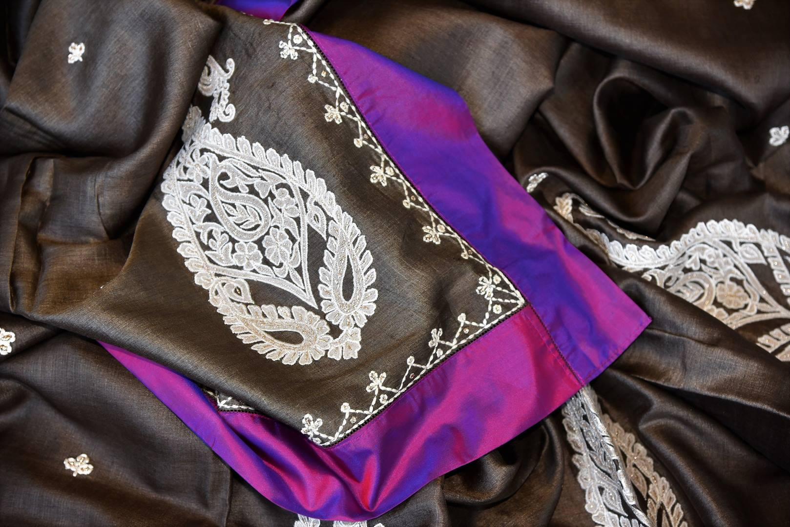 Buy dark grey applique work tussar saree online in USA with purple border. Be the talk of every occasions with your elegant saree look in designer sarees, embroidered sarees, handwoven silk sarees from Pure Elegance Indian fashion store in USA.-details