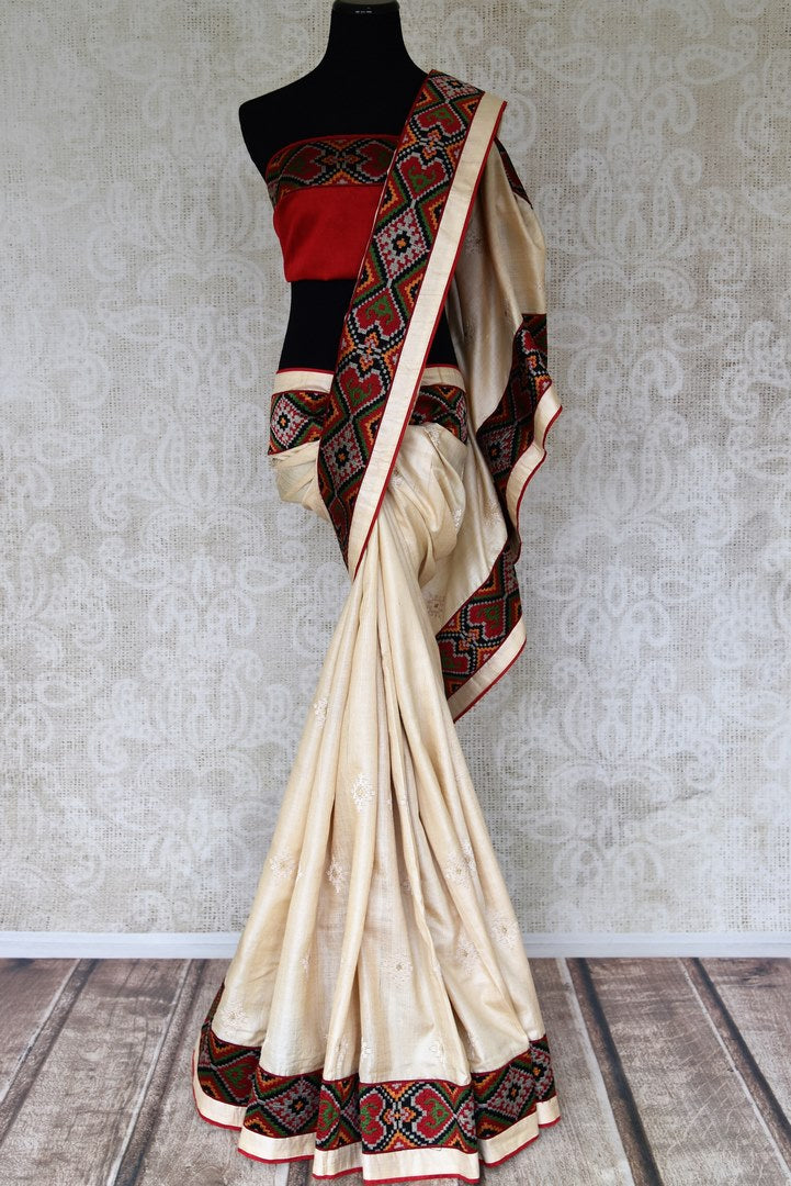 Buy cream embroidered tussar silk sari online in USA with ikat border. Select your favorite Indian handloom saris, pure silk sarees, wedding sarees from Pure Elegance Indian fashion store in USA for weddings and special occasions.-full view