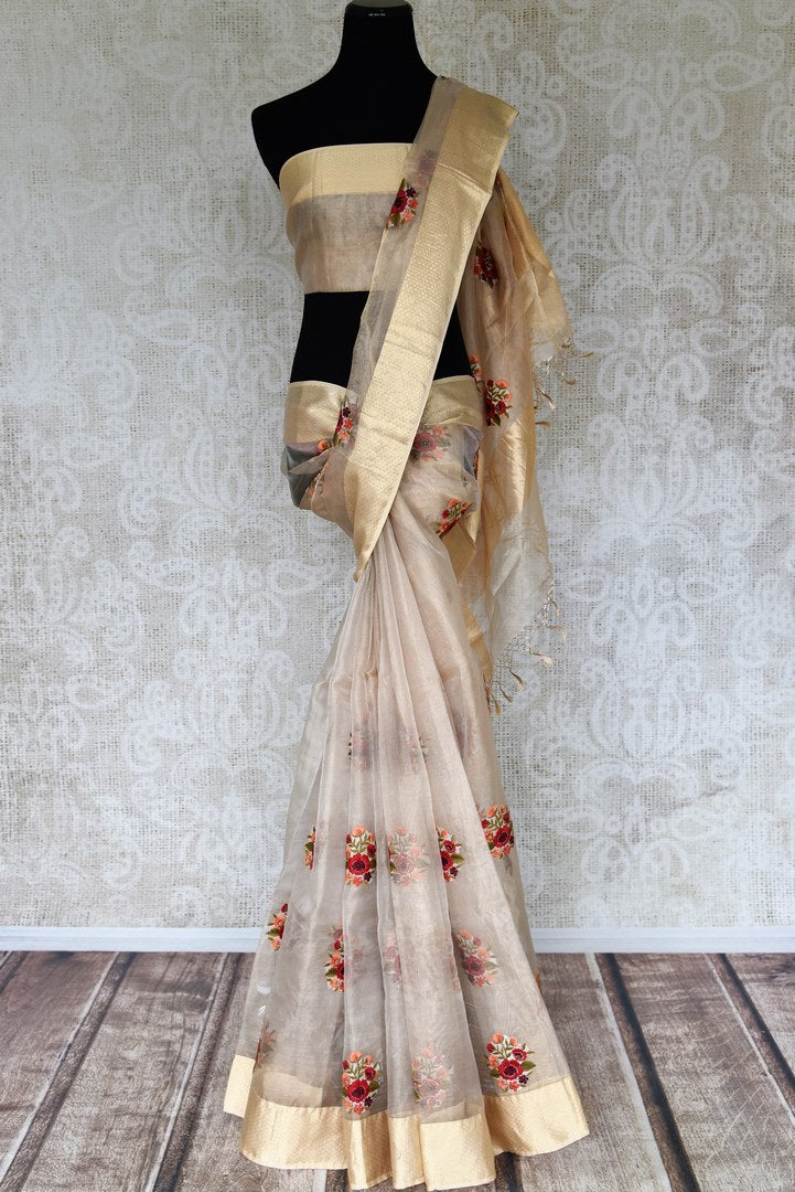 Buy cream resham embroidery tissue linen saree online in USA with zari border. Select your favorite Indian handloom saris, pure silk sarees, wedding sarees from Pure Elegance Indian fashion store in USA for weddings and special occasions.-full view