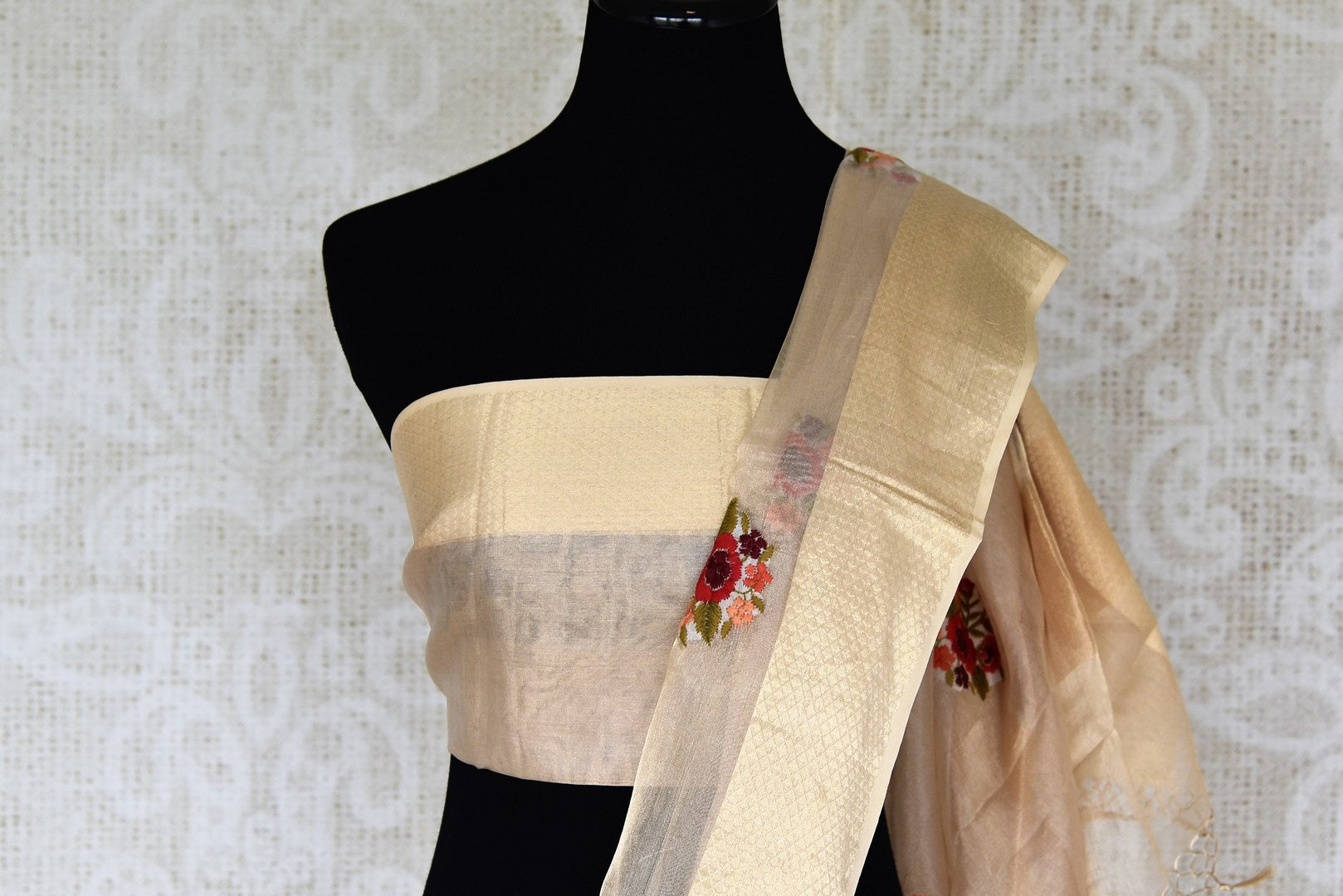 Buy cream resham embroidery tissue linen saree online in USA with zari border. Select your favorite Indian handloom saris, pure silk sarees, wedding sarees from Pure Elegance Indian fashion store in USA for weddings and special occasions.-blouse pallu