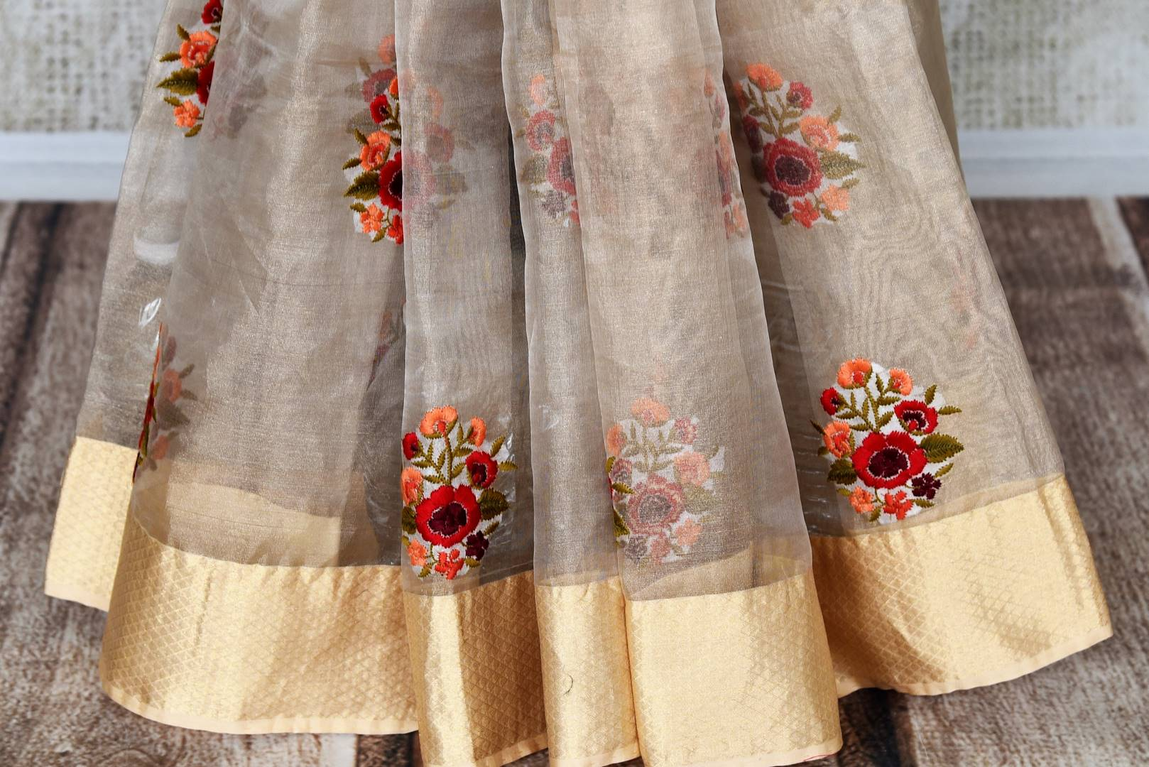 Buy cream resham embroidery tissue linen saree online in USA with zari border. Select your favorite Indian handloom saris, pure silk sarees, wedding sarees from Pure Elegance Indian fashion store in USA for weddings and special occasions.-pleats