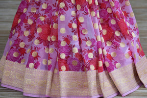 Shop pink floral georgette Banarasi saree online in USA with zari border. Radiate traditional charm with beautiful Banarasi sarees from Pure Elegance Indian clothing store in USA. Choose from a variety of Banarasi silk sarees, Banarasi georgette sarees, Banarasi tussar saris for special occasions.-pleats