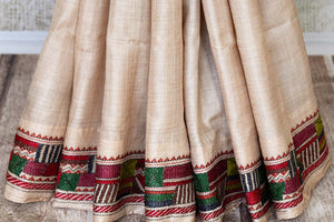 Buy beige and red silk saree online in USA with multicolor kantha work border. Make special occasions even more special with your captivating traditional style in Banarasi sarees from Pure Elegance Indian clothing in USA.-pleats