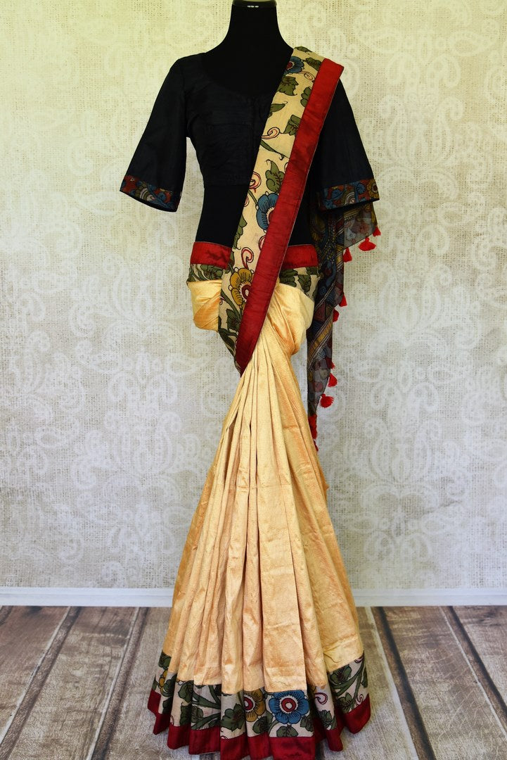 Buy graceful cream raw silk sari online in USA with hand painted Kalamkari border and black sari blouse. Elevate your traditional glam on weddings and special occasions with an exclusive range of handwoven sarees, designer saris especially for Indian women in USA at Pure Elegance Indian fashion store. Shop now.-full view