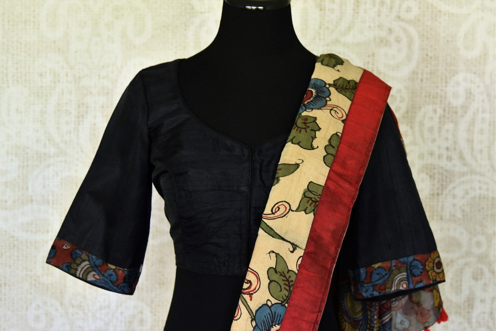 Buy graceful cream raw silk sari online in USA with hand painted Kalamkari border and black sari blouse. Elevate your traditional glam on weddings and special occasions with an exclusive range of handwoven sarees, designer saris especially for Indian women in USA at Pure Elegance Indian fashion store. Shop now.-blouse pallu