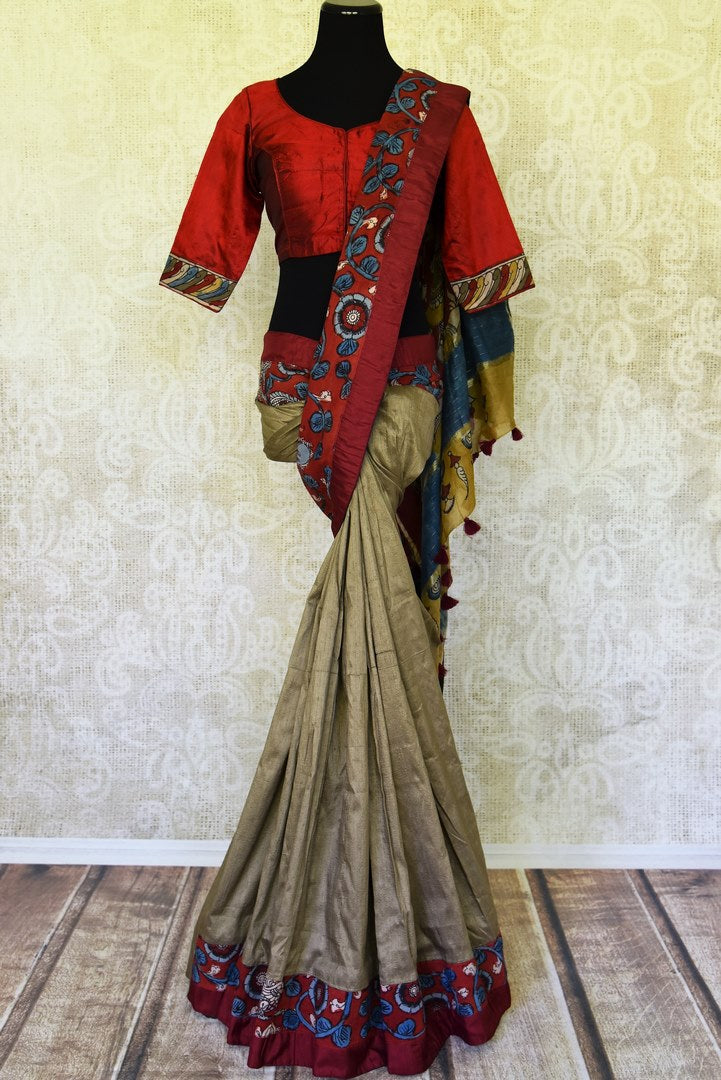 Shop grey raw silk saree online in USA with hand painted Kalamkari border and red sari blouse. Elevate your traditional glam on weddings and special occasions with an exclusive range of handwoven sarees, designer saris with blouses especially for Indian women in USA at Pure Elegance Indian fashion store. -full view