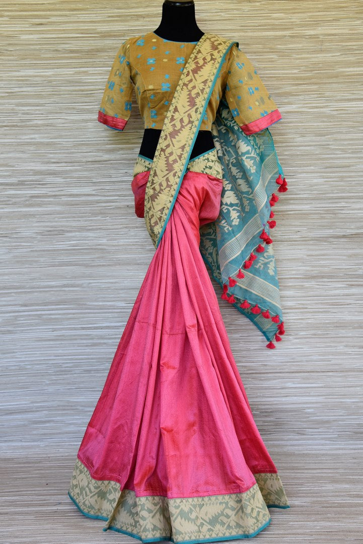 Buy gorgeous pink raw silk sari online in USA with beige dhakai border and saree blouse. Stand amongst the crowd with your tasteful ethnic style in beautiful handwoven silk saris from Pure Elegance Indian fashion store for Indian women in USA.-full view