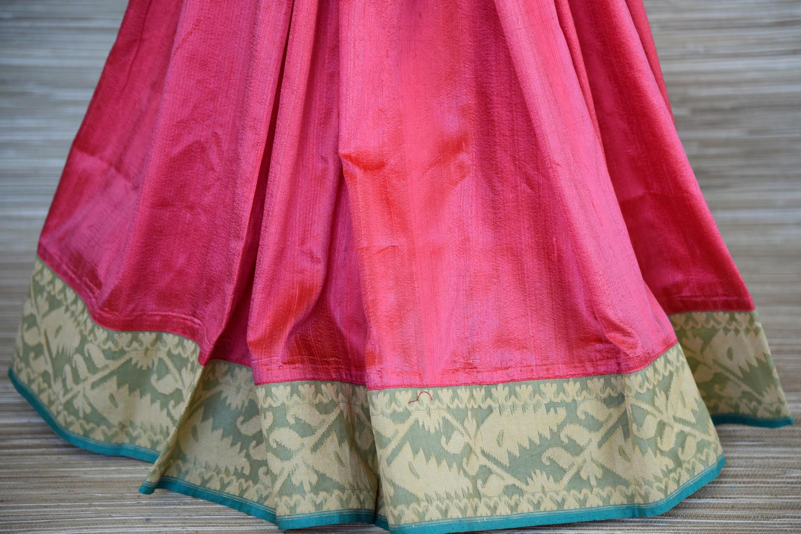 Buy gorgeous pink raw silk sari online in USA with beige dhakai border and saree blouse. Stand amongst the crowd with your tasteful ethnic style in beautiful handwoven silk saris from Pure Elegance Indian fashion store for Indian women in USA.-pleats