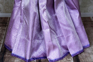Buy lavender color silver zari work Kanjivaram sari online in USA. Shop beautiful Kanchipuram silk sarees, designer saris, handwoven silk sarees for special occasions from Pure Elegance Indian fashion store in USA.-pleats