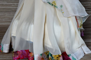 Buy gorgeous white floral georgette organza ruffle saree online in USA with designer blouse. Be a vision in the exquisite designer sarees from Pure Elegance Indian clothing store in USA. Shop online now.-pleats