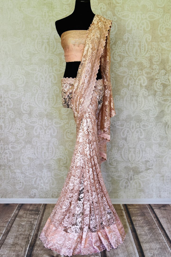 Buy stunning powder pink lace saree online in USA with stone work. Be the highlight of every occasion with beautiful embroidered designer saris from Pure Elegance Indian clothing store in USA. Shop online now.-full view