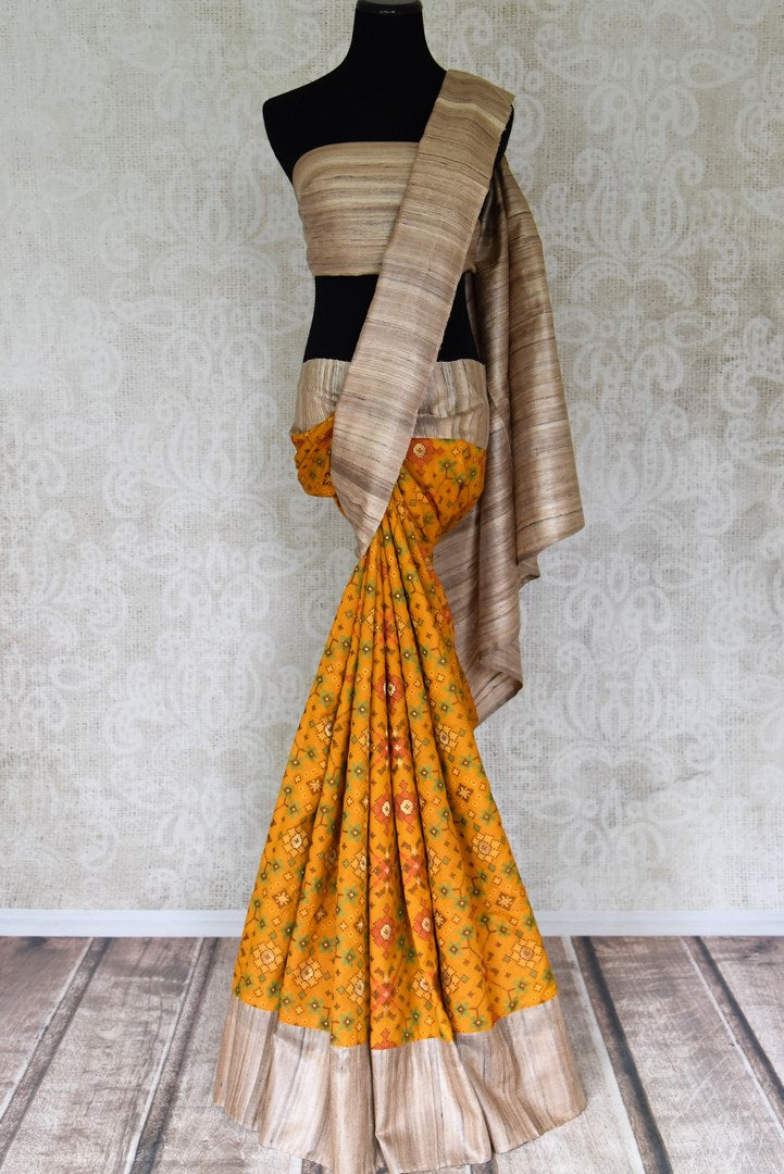 Shop beautiful mustard patola silk saree online in USA with beige border. Shop the latest Indian women clothing and handwoven silk sarees for weddings and special occasions from Pure Elegance Indian clothing store in USA.-full view