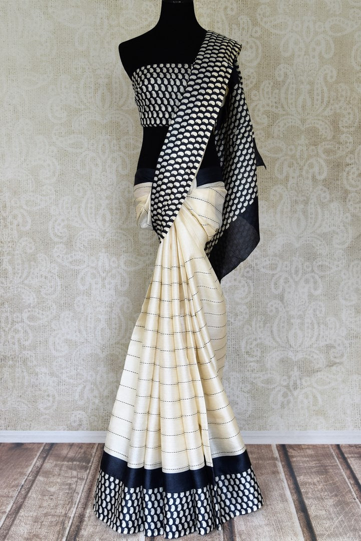 Buy cream kantha work tussar silk saree online in USA with black paisley print border. Update your ethnic wardrobe with latest Indian sarees, pure silk sarees, designer sarees and Indian clothing from Pure Elegance Indian clothing store in USA.-full view
