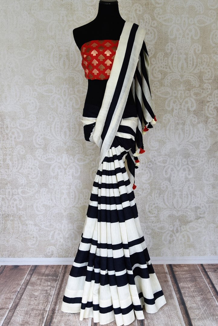 Shop off-white and black striped tussar saree online in USA with red Banarasi blouse piece. Update your ethnic wardrobe with latest Indian sarees, pure silk sarees, designer sarees and Indian clothing from Pure Elegance Indian clothing store in USA.-full view