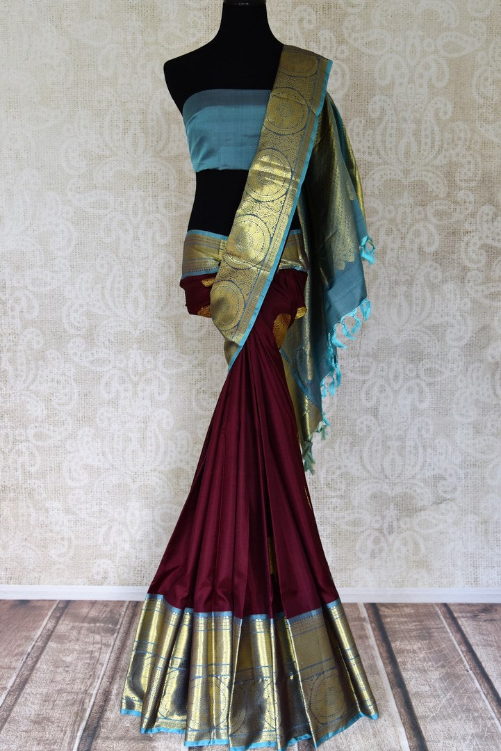Shop plum color Kanjivaram sari online in USA with blue zari border. Enhance your ethnic style with exquisite Kanchipuram silk sarees from Pure Elegance Indian clothing store in USA.-full view