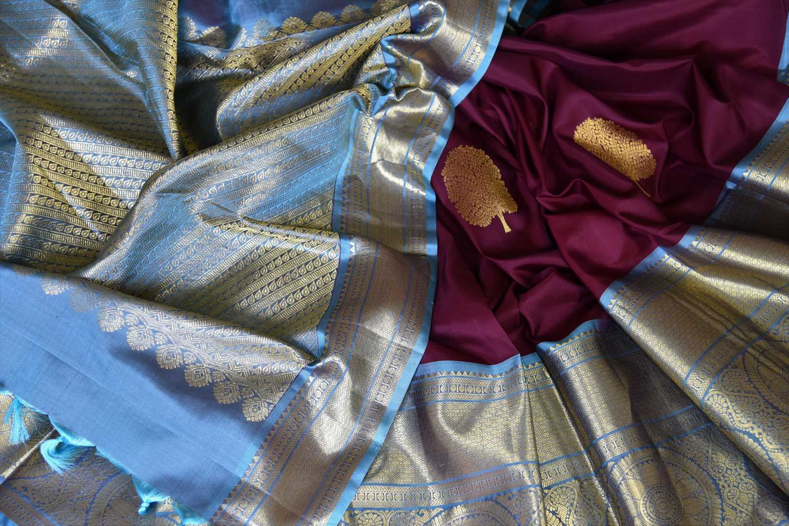Shop plum color Kanjivaram sari online in USA with blue zari border. Enhance your ethnic style with exquisite Kanchipuram silk sarees from Pure Elegance Indian clothing store in USA.-details