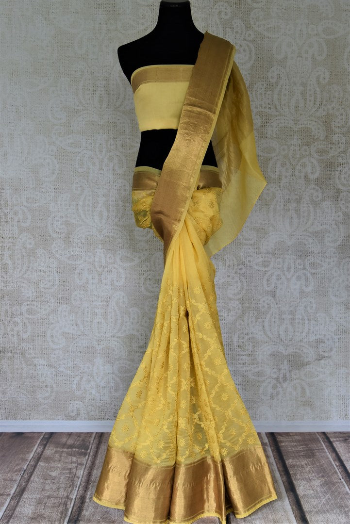 Shop stunning yellow embroidered organza sari online in USA with golden zari border. Enter the world of exquisite designer sarees and Indian clothing at Pure Elegance Indian clothing store in USA. Shop handwoven sarees, Banarasi sarees, soft silk sarees online or from our store.-full view