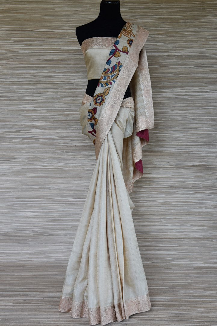 Shop cream embroidered tussar saree online in USA with zari border. Update your saree wardrobe this festive season with latest designer sarees. soft silk sarees, handwoven saris from Pure Elegance Indian cloth store in USA. Shop online  now.-full view