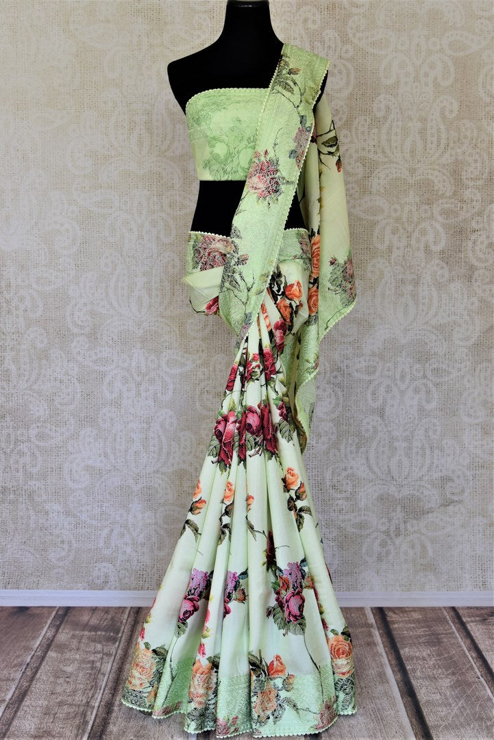 Buy gorgeous mint green floral crepe silk saree online in USA with embroidered border. Enhance your traditional style at weddings and festive occasions with beautifully curated collection of Banarasi sarees, pure silk sarees, designer saris from Pure Elegance Indian clothing store in USA.-full view