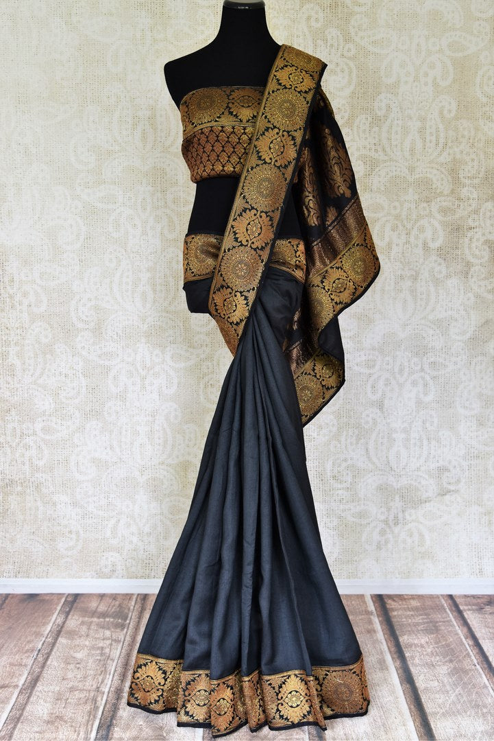 Buy elegant black muga silk sari online in USA with Banarasi border. Be the talk of weddings and other special occasions with your striking look in stunning Banarasi sarees, handloom silk saris from Pure Elegance Indian fashion store in USA.-full view