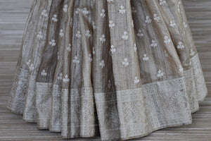 Shop beautiful green and beige half and half embroidered tussar saree online in USA. Update your saree wardrobe this festive season with latest designer sarees. soft silk sarees, handwoven saris from Pure Elegance Indian cloth store in USA. Shop online  now.-pleats