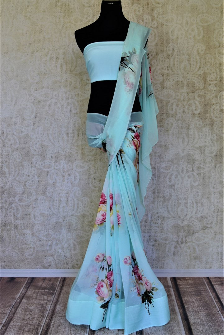 Shop charming pastel blue floral georgette saree online in USA. Shop such gorgeous printed sarees, designer sarees in USA from Pure Elegance Indian clothes store in USA for special occasions.-full view