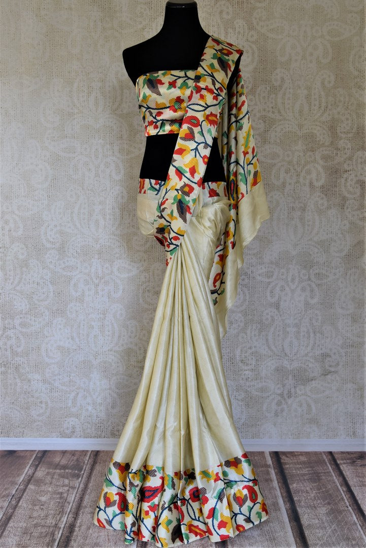 Buy off-white crepe silk sari online in USA with printed floral border. Shop stunning printed sarees, georgette sarees, floral sarees in USA from Pure Elegance Indian cloth boutique in USA. Visit our store now.-full view