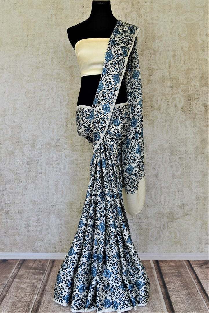 Buy elegant cream and blue printed crepe silk sari online in USA. Be the center of attraction at parties and weddings with exquisite designer saris, print sarees, Bollywood sarees from Pure Elegance Indian fashion store in USA.-full view