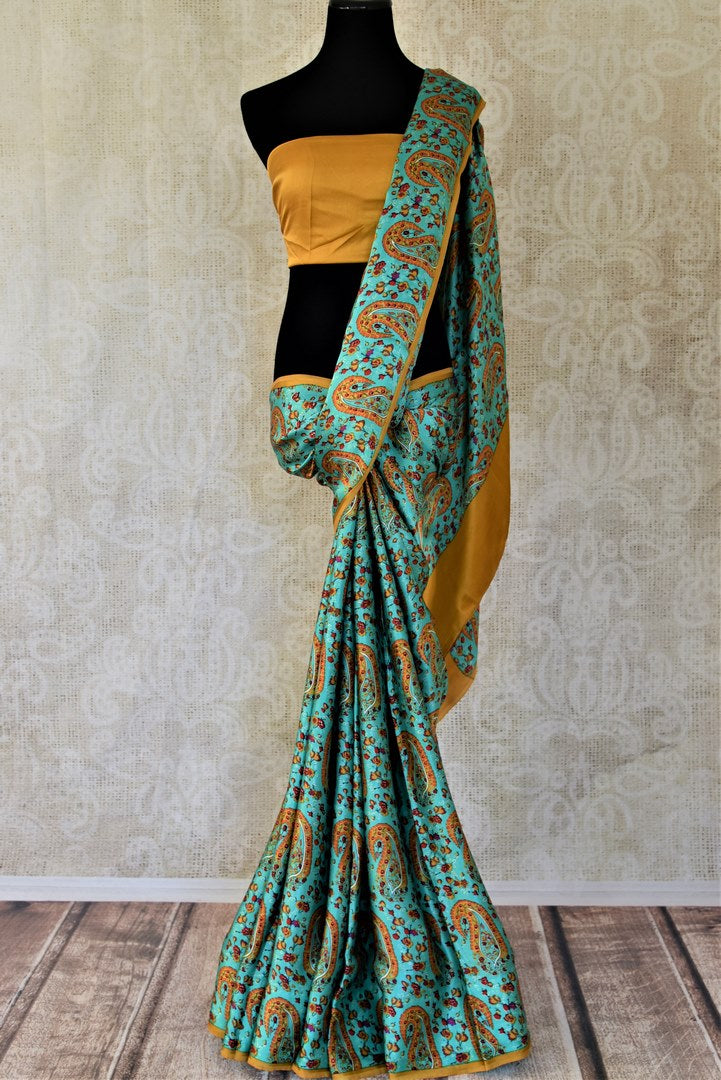 Shop turquoise green paisley floral print crepe silk saree online in USA. Be the center of attraction at parties and weddings with exquisite designer saris, print sarees, Bollywood sarees from Pure Elegance Indian fashion store in USA.-full view