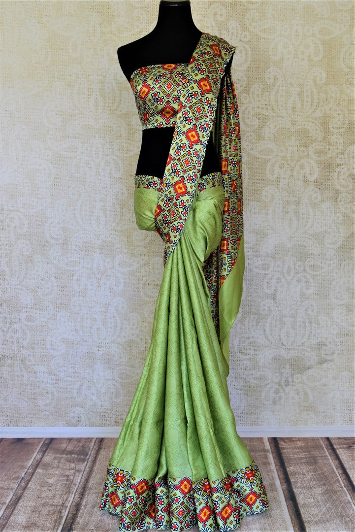 Shop pista green crepe silk sari online in USA with printed border. Be the center of attraction at parties and weddings with exquisite designer sarees, print sarees, Bollywood sarees from Pure Elegance Indian fashion store in USA.-full view
