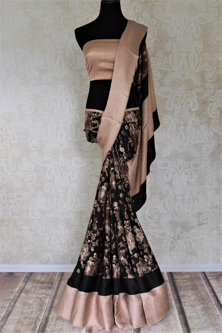 Buy black floral print crepe silk saree online in USA with beige border. Be the center of attraction at parties and weddings with exquisite designer sarees, print sarees, Bollywood sarees from Pure Elegance Indian fashion store in USA.-full view