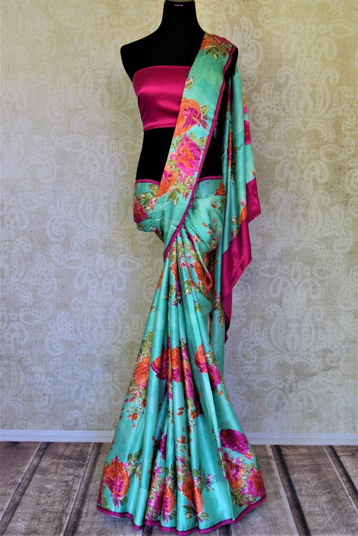 Buy beautiful turquoise green pink floral print crepe silk saree online in USA. Be the center of attraction at parties and weddings with exquisite designer sarees, print sarees, Bollywood sarees from Pure Elegance Indian fashion store in USA.-full view